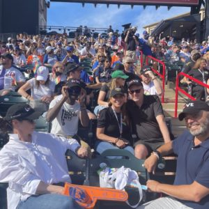 God's Love staff an a crowd at the New York Mets game
